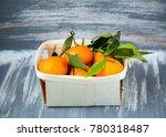 fresh orange tangerines with... | Shutterstock . vector #780318487