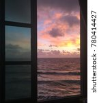 isla mujeres window sunset | Shutterstock . vector #780414427