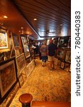 Small photo of PACIFIC OCEAN - DEC 12, 2017 - Art auction aboard a cruise ship, eastern Pacific Ocean