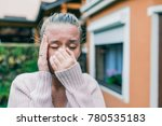 Small photo of Sinus ache causing very paintful headache. Unhealthy woman in pain. Sharp strong sore. Sinus pain, sinus pressure, sinusitis. Sad woman holding her nose and head because sinus pain