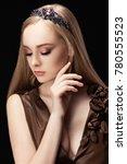 portrait of a beautiful blonde... | Shutterstock . vector #780555523