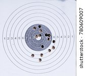 Small photo of Sport shooting circle target accuracy bullet hole
