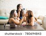 pretty young female friends... | Shutterstock . vector #780694843