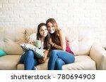 portrait of a pair of hispanic... | Shutterstock . vector #780694903