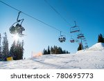 low angle shot of a ski lift in ... | Shutterstock . vector #780695773