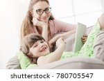 young mother and daughter using ... | Shutterstock . vector #780705547
