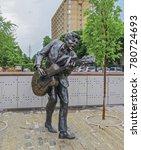 Small photo of Saint Louis, MO USA - 04/12/2014 - Saint Louis, MO USA - Saint Louis Blues Legend Chuck Berry Statue