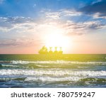 Small photo of cabotage ship in a sea at the sunset