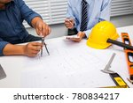 engineers and businessmen are... | Shutterstock . vector #780834217