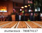 empty wooden table and blurred... | Shutterstock . vector #780874117