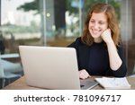 smiling woman looking at laptop ... | Shutterstock . vector #781096717
