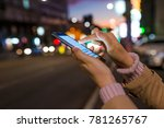 woman using her mobile phone ... | Shutterstock . vector #781265767