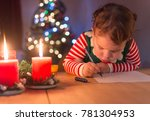 a cute little girl writes on... | Shutterstock . vector #781304953