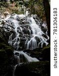 secret waterfall in winter time ... | Shutterstock . vector #781306183