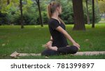 young girl practicing yoga in... | Shutterstock . vector #781399897