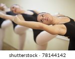 Ballerina practicing on the bar - stock photo