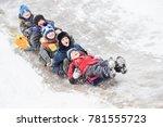 children having fun riding ice... | Shutterstock . vector #781555723