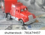 a toy car on money background | Shutterstock . vector #781674457
