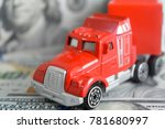 a toy car on money background | Shutterstock . vector #781680997
