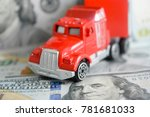 a toy car on money background | Shutterstock . vector #781681033