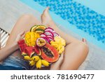 young woman relaxing and eating ... | Shutterstock . vector #781690477