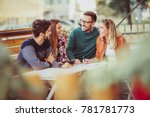 group of four friends having... | Shutterstock . vector #781781773