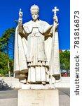 Small photo of FATIMA, PORTUGAL - SEPTEMBER 17, 2017 Pope Pius XII Statue Basilica of Lady of Rosary Fatima Portugal. Site three Portuguese Shepherd children saw Virgin Mary. Basilica created 1953. Statue ere