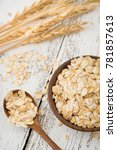 raw rolled oats  oat flakes and ... | Shutterstock . vector #781857613