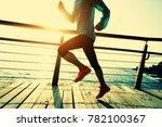 sporty fitness female runner... | Shutterstock . vector #782100367