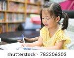 cute little girl doing homework ... | Shutterstock . vector #782206303