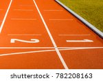 Small photo of All-weather running track for athletes or people who want to practice and exercise next to the green glass field.