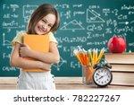 heppy kid with yellow book | Shutterstock . vector #782227267