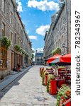 Small photo of Quebec City, Quebec / Canada - 01 August 2015: Tourist are walking at the end of the street and enjoying the sun in Quebec.