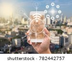 holding smart phone showing the ... | Shutterstock . vector #782442757
