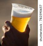 fresh beer in a plastic cup in...   Shutterstock . vector #782590657
