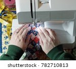 hands using a sewing machine | Shutterstock . vector #782710813