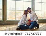 a loving couple with a red... | Shutterstock . vector #782737333