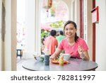 asian girl eating noodles in... | Shutterstock . vector #782811997