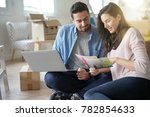 couple choosing paint colours...   Shutterstock . vector #782854633