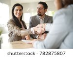 couple in bank office signing... | Shutterstock . vector #782875807