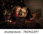 two girl open christmas gifts.... | Shutterstock . vector #782962297