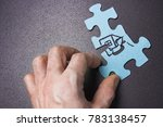 Small photo of person's hand piles up puzzle with house close-up. Concept house. Construction and home insurance
