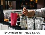 male hands of the bartender...   Shutterstock . vector #783153703