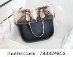 black handbag with fur alone in ... | Shutterstock . vector #783324853