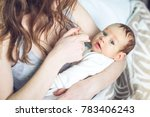 happy caring mother holding a... | Shutterstock . vector #783406243