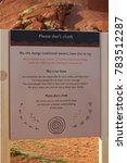 Small photo of AUSTRALIA, NORTHERN TERRITORY, ULURU-KATA TJUTA NATIONAL PARK, AUGUST 09, 2016: Metal plate with the request from the Anangu people that nobody should climb on the Uluru