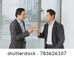 two young businessmen in suits... | Shutterstock . vector #783626107