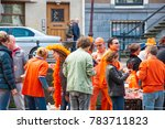 Small photo of AMSTERDAM-APRIL 27: Locals in orange take part at celebration Koningsdag (King's Day) on April 27,2015, the Netherlands. King's Day festivities invite locals and visitors alike to soak up open-air fun