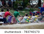 Small photo of SIEM REAP, CAMBODIA - NOVEMBER 2016: Medium view of team of boat racers paddling hard in action during a practice trial run for the annual boat races in Cambodia.