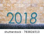 2018 text on wall with water... | Shutterstock . vector #783826513
